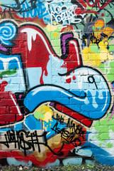 Abstract graffiti on the textured brick wall