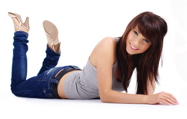 fashion woman portrait where she is smiling on the floor over a