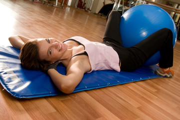 Beautiful Woman Doing Pilates with Ball