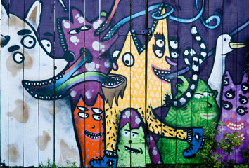 Abstract graffiti on the wooden fence