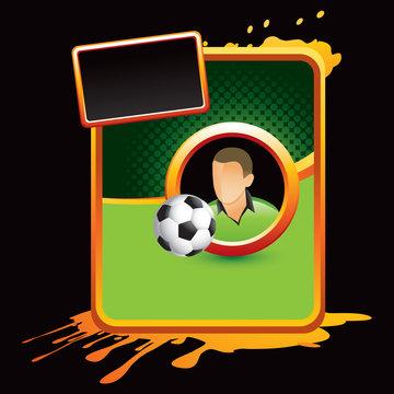 Soccer player and ball on orange splattered banner