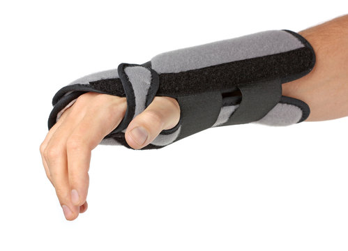 Human hand with a wrist brace, orthopeadic equipment
