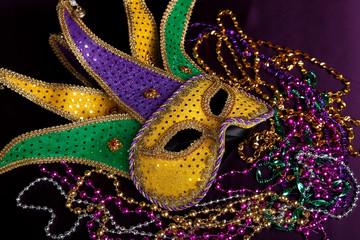 Fototapeta Mardi gra mask and beads on a purple background obraz