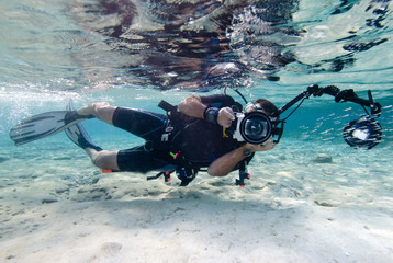 An underwater photographer in shallow water.
