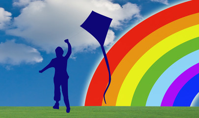 child silhouette plays with kite against background rainbow