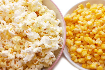 Tinned corn and popcorn in plates