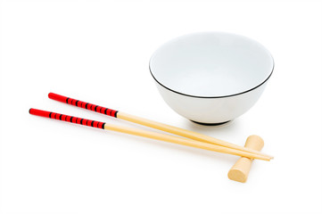 Bowl and chopsticks isolated on the white
