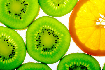 Green kiwi with one orange slice