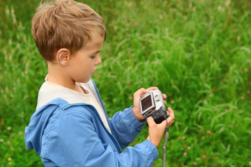 boy with photo camera outdoor