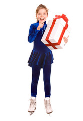 Girl in blue sport dress on skates with gift box.Isolated.