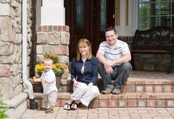 Happy Family of Three Smiling