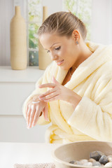 Woman using hand cream