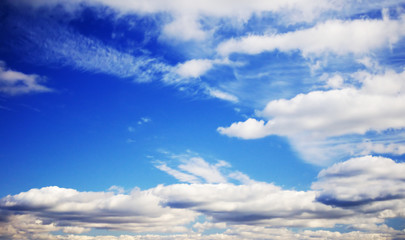 Cloudy midday blue sky