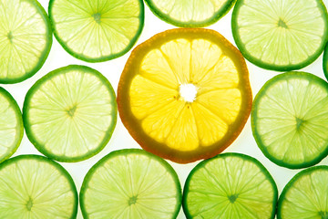 Yellow lemon and green lime slices