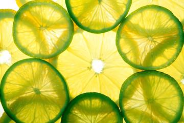 Yellow lemon and green lime slices