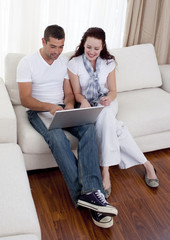 Couple using a laptop to buy online