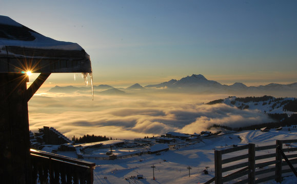 View of Avoriaz sunset over mist in valley
