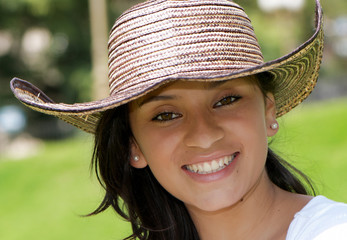 The beautiful Colombian girl in a hat