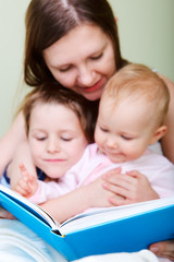 Family reading in bed