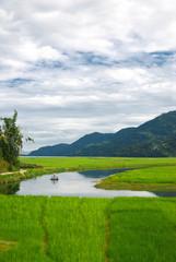 Farmers in the water reflection,fewa lake,nepal