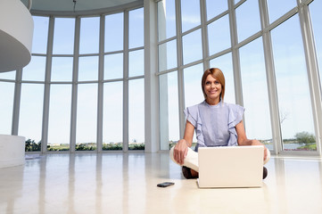 Woman with a laptop and mobile phone