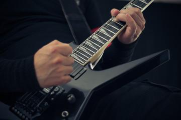 Playing rock guitar close-up