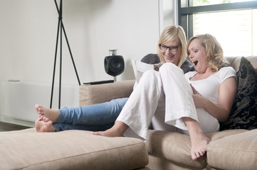girlfriends on a sofa