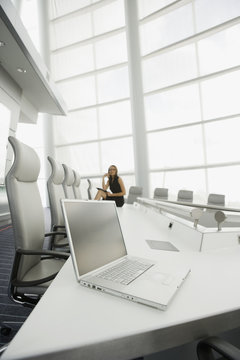 African businesswoman and laptop in conference room