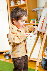 Preschool boy painting