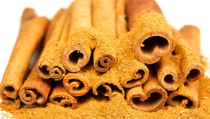 Cinnamon bark and powder isolated on white
