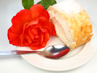 Cream cake with rose closeup