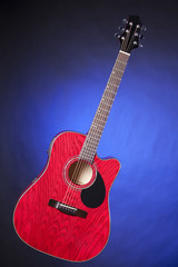 Red Guitar Isolated on Blue