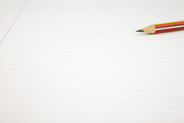 Close up of a  Blank white lined Notepad with a pencil coming in