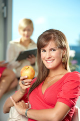 Businesswoman with apple