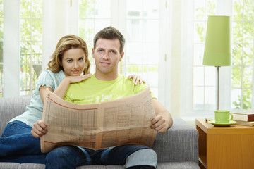 Love couple reading news