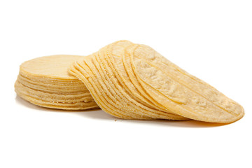 Stack of corn tortillas on white