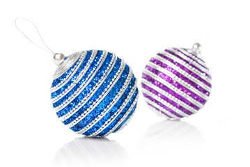 pink and blue christmas balls isolated on white