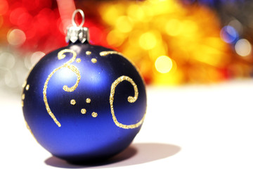 Dark blue christmas ball with gold pattern on abstract backgroun