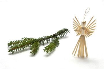 Straw angel with spruce branch