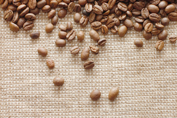 coffee beans on a burlap texture background