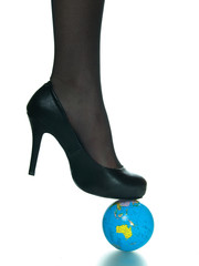 Sexy girl foot on top of planet earth globe
