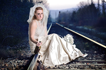 Disappointed bride on a railway