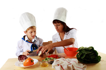 Mother and son cooking happily isolated on white