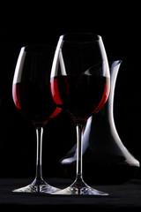 a two wine glasses on black