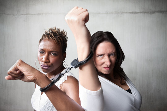 Angry women in handcuffs