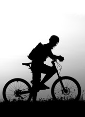 adventure cycling in the nature - mountain biker silhouette