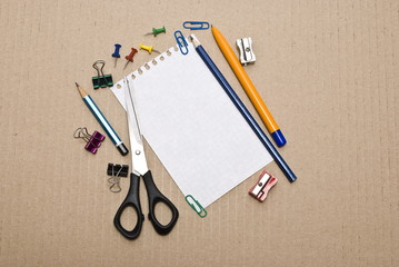 Office tools on cardboard background