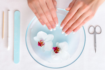 Woman Preparing hands for manicure procedure