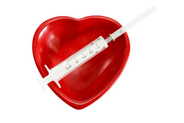 Red heart and medical syringe