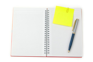 note and pen on a notebook